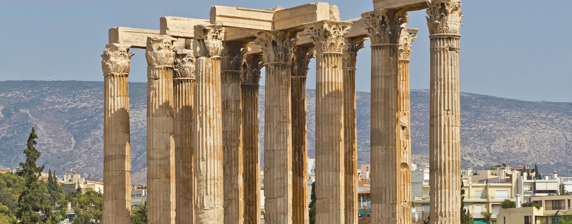Enjoy first class deals to Athens and tours of Delphi for divine inspiration. - IFlyFirstClass